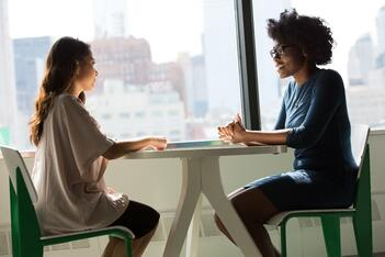 A public adjuster meets with a client to discuss her claim