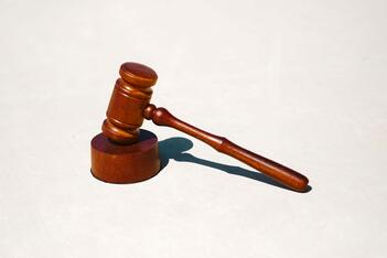 A court gavel, representing the fine against Florida insurance companies