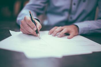 A man writing off a denied insurance claim