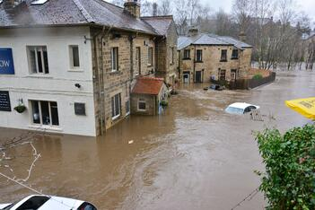 A flooded street, creating enormous water damage