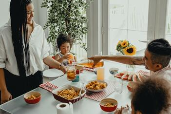 A family enjoys a meal at home