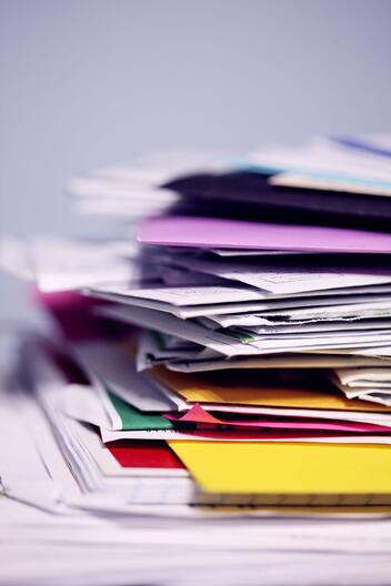 A messy stack of insurance documents
