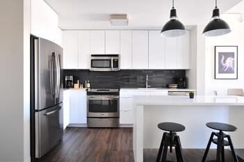 A perfectly maintained white kitchen with wood furnishings