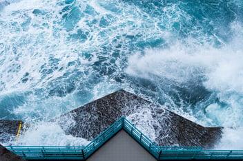 A hurricane begins pounding a marina