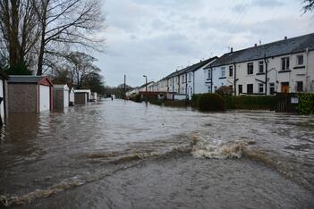 A heavily flooded street, resulting in significant water damage