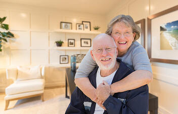 An elderly couple in their home