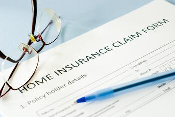 A home insurance claim form being prepared for filing