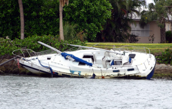 A boat capsized at a dock after a recent hurricane