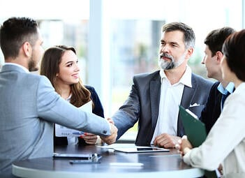 A public adjuster meets with insurance claimants