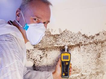 A Florida mold remediation specialist at work after a recent flood.