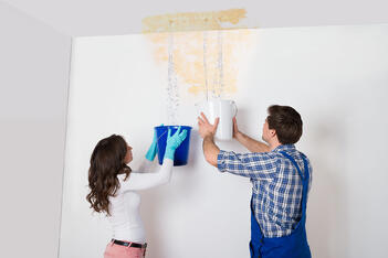 A couple tried to stop a roof leak with buckets