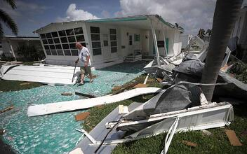 A small home in Florida is covered in debris after a recent hurricane