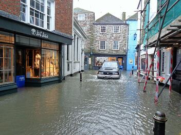 A flood damaged street, almost entirely submerged in water