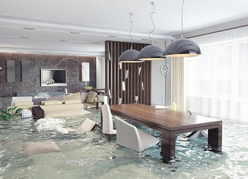 A beautiful dining room is overwhelmed with water, causing significant damage.