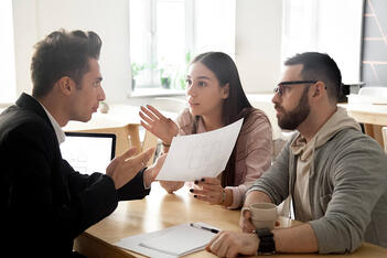 An insurance agent argues with clients about their plan