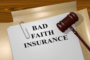 A file depicting a bad faith insurance claim sits on a desk