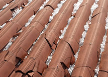 Cracked clay roof tiles damaged after a recent hurricane