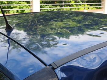 A car in Southern Florida is dented after a hail storm.