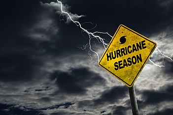 A hurricane warning sign in the midst of a Florida storm.