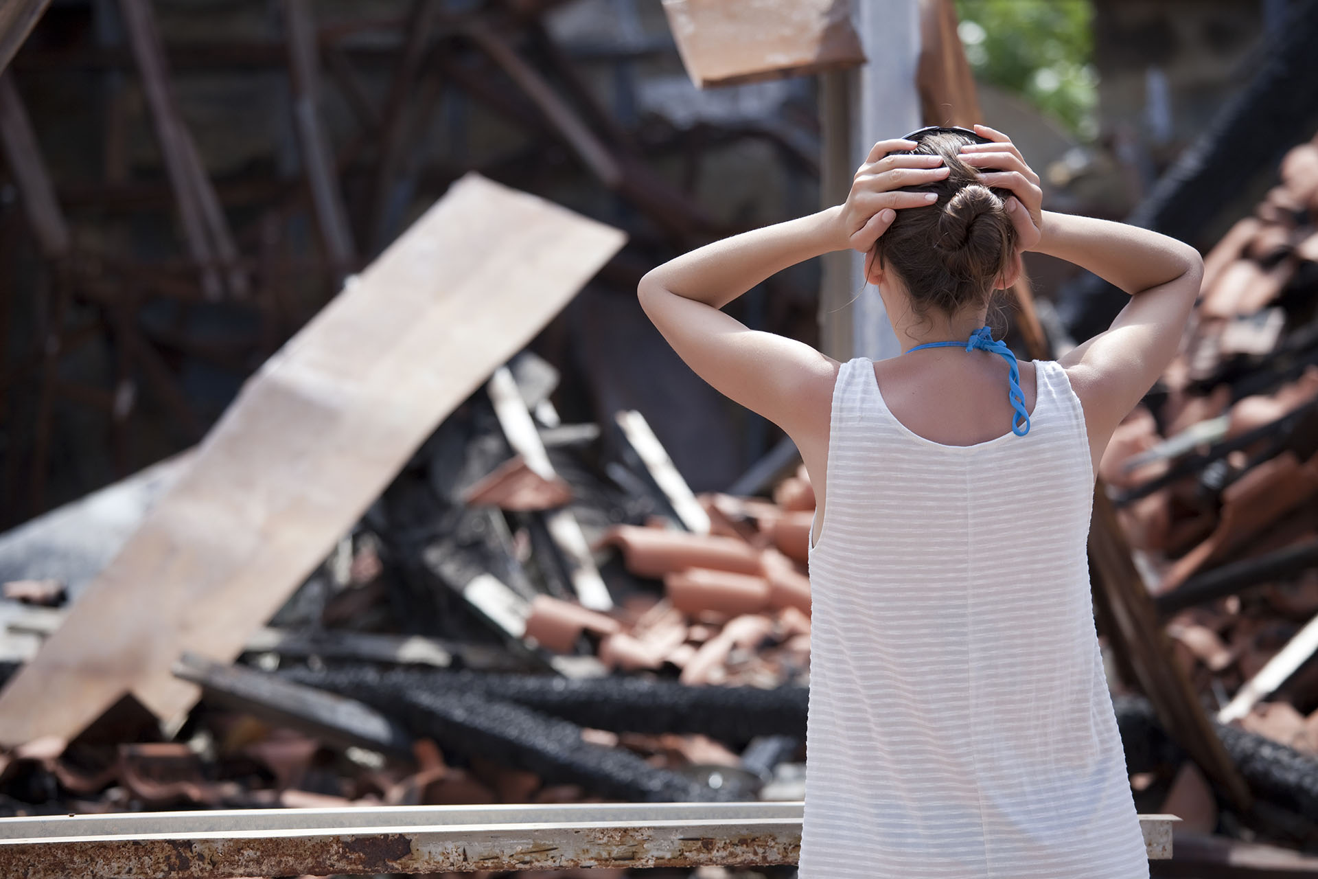 A Florida homeowner looks in shock at the remains of her home.