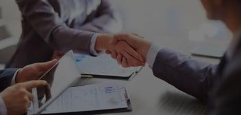 A handshake after a public adjuster obtains handsome compensation for yet another Fort Lauderdale client.
