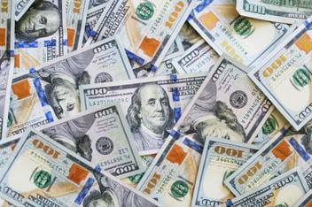 A pile of one hundred dollar bills from an insurance bonus