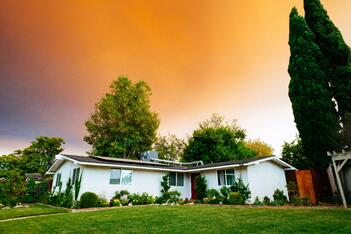 A perfectly maintained home at sunset