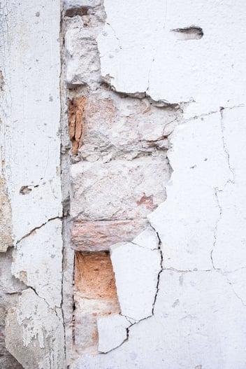 A close up image of a damage Stucco wall