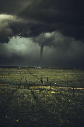 A tornado traveling across an open field
