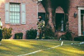 Firefighters inspect a fire damaged home in Florida.