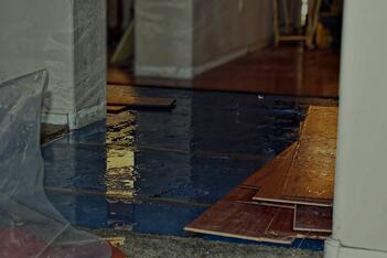 A home in Florida with it's wood flooring removed due to water damage