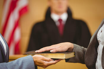 A swearing-in inside a federal court room, where insurance claim sometimes end up.